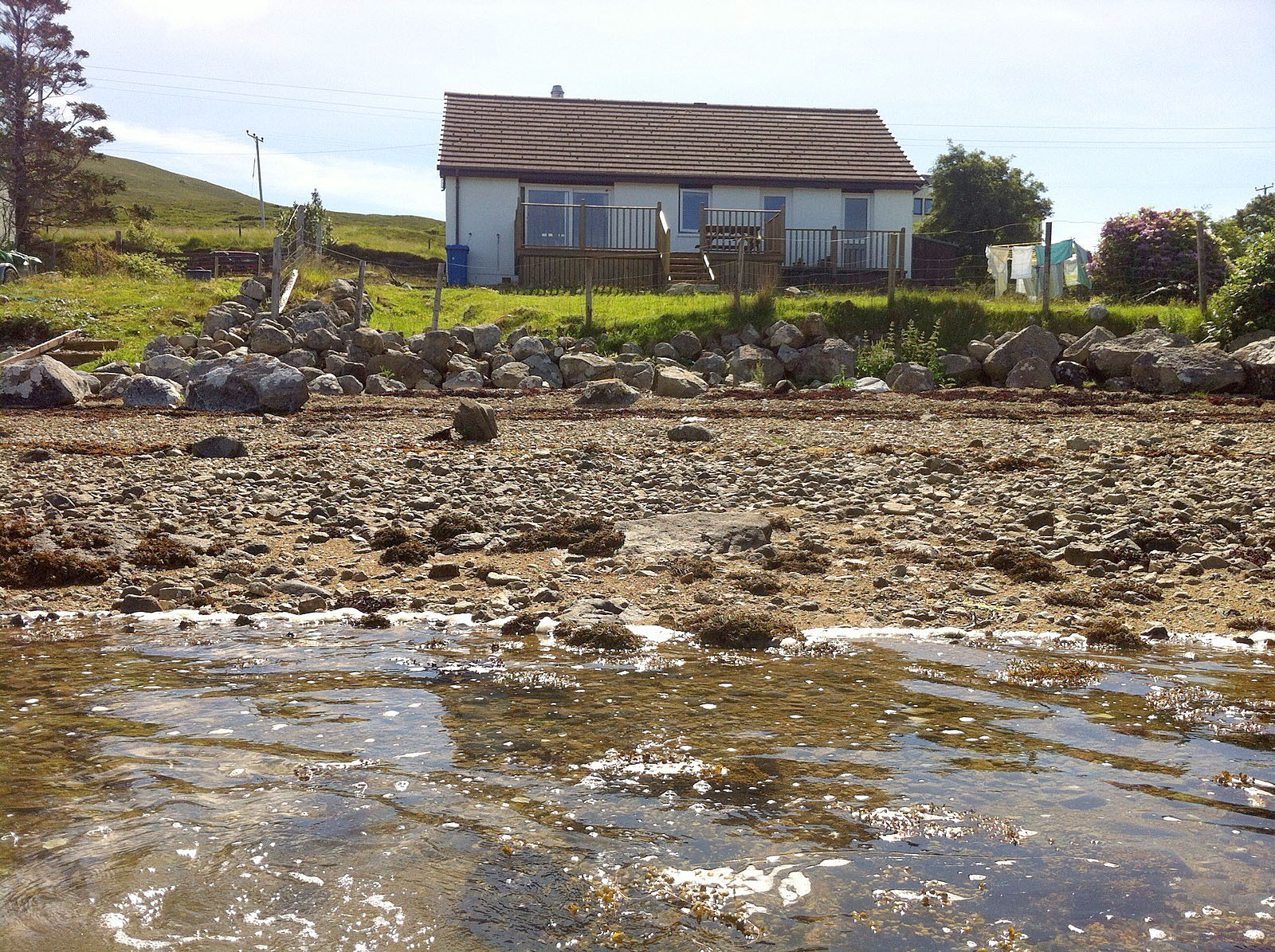 The view from the sea at Otters Leap cottage, Skye